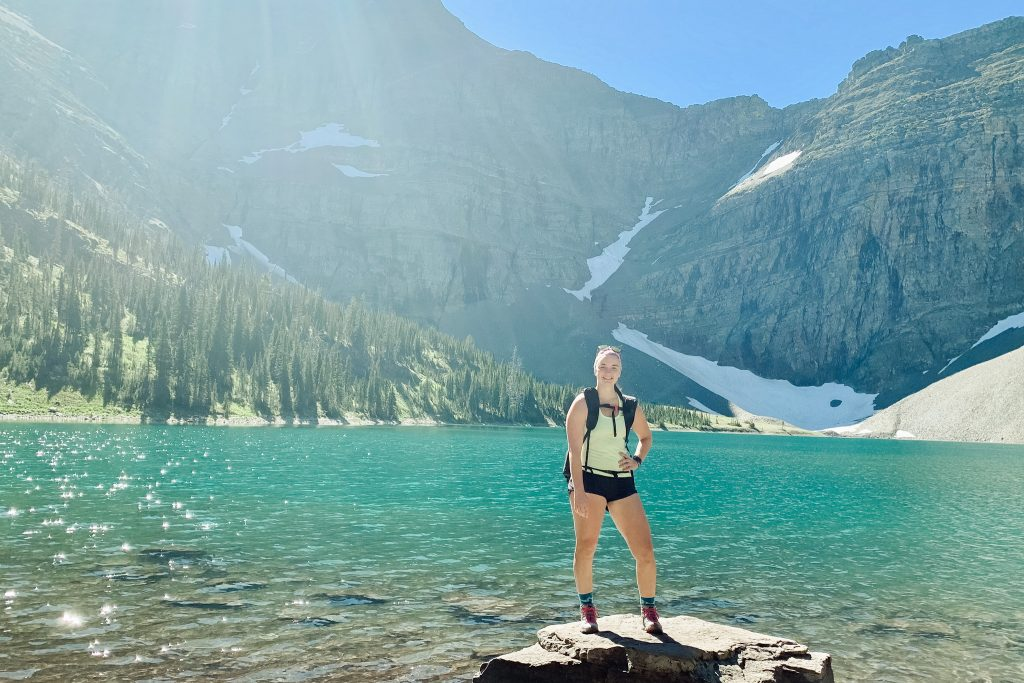 Shows the website author standing in front of an alpine lake