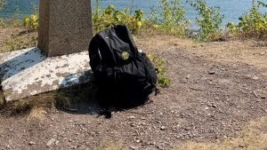 Six Moon Designs DayBreak DayPack leaning against a monument