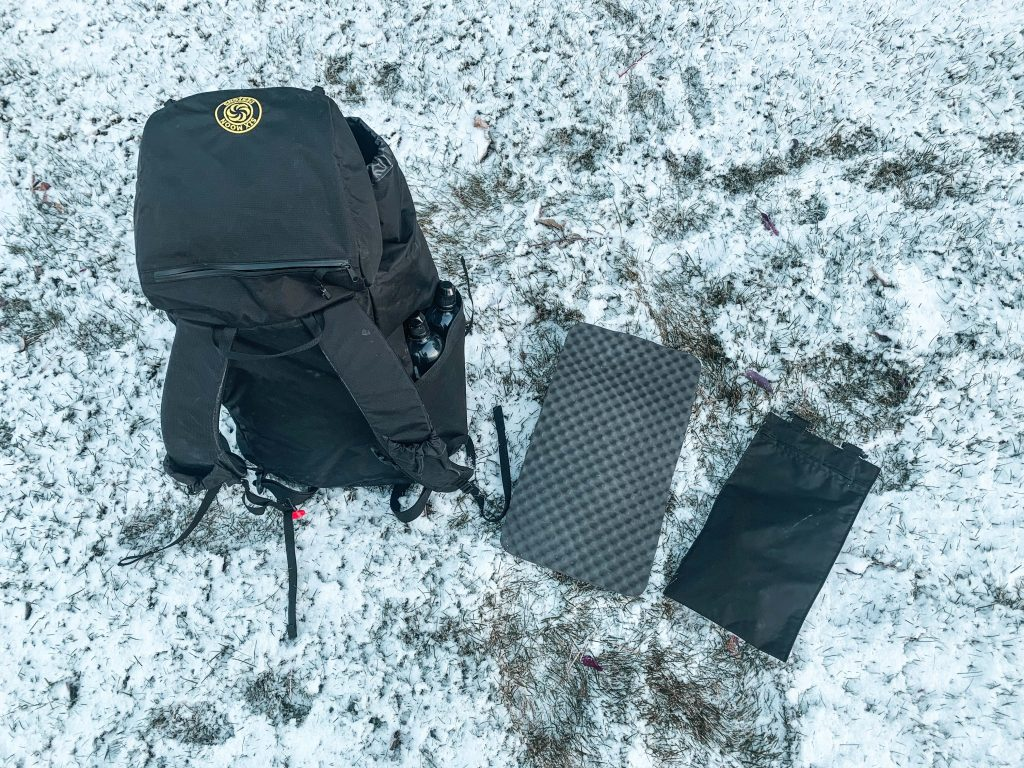 Six Moon Designs DayBreaker DayPack Top View with removable sitpad and hydration bladder
